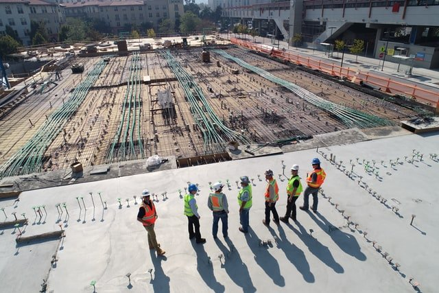 a camera view of construction workers standing in a jobsite